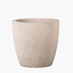 The Bollé cast stone planter, with its unique and bubble-like texture and streamlined shape, will add visual interest to any contemporary design theme.