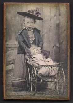 ~Photo Of  Anonymous Girl & Her Doll~  Reallllly like the doll carriage too!!! Most of all, love the adorable hat adoring her sweet face at an angle, like a french beret!!!