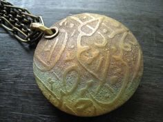 Bronze Lentil Pendant by Celie Fago