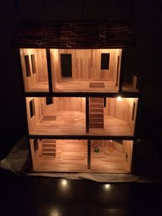 Dollhouse completely made out of Popsicle sticks! Over 700 sticks involved. Even lights up at night!