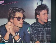 Rare shot of Rob Lowe and Judd Nelson. Lowe's outfit is amazing. The watch, the sports jacket, the tortoise shell glasses, the chin...