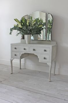 I don't want to pay this much but I need a vanity table and I'm willing to refurbish and paint it! So keep your eyes open for it! Xoxo....  Edwardian Dressing Table with Adjustable Bevelled Mirrors painted in a shabby chic style with Annie Sloane Old White and  Paris Grey paints on Etsy, $484.08