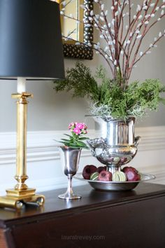 It's time to pull out your silver and start polishing. Look at this stunning holiday arrangement. Those are dried limes and pomegranates at the base. Christmas Decorations, Table Decorations, Holiday Decor, Holiday Ideas, Centerpieces, Urn Planters, Old Fashioned Christmas, Home Office Decor, Home Decor