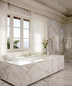 The master bath of this Napa, California, home decorated by the Wiseman Group features marble from Walker Zanger, Kallista bath fittings, and a Murano Nevada chandelier by Barovier & Toso. Glamorous Bathroom, Beautiful Bathrooms, Modern Bathroom, Master Bathroom, Luxurious Bathrooms, Colorful Bathroom, Bathroom Bath, Architectural Digest, Bad Inspiration
