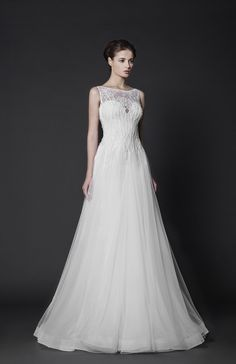 Off-White A-line Lace dress with sheer overlay embroidered bust and Tulle skirt, featuring a crinoline hemline.