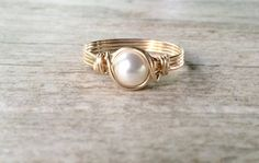 This Pearl ring features a beautiful 6mm Swarovski Pearl, wire wrapped in 14k Gold Filled wire. Perfect for everyday wear, or for a special occasion! This ring would make a beautiful engagement ring, wedding ring, or bridal gift. Pearl is also one of the Birthstones for June. This