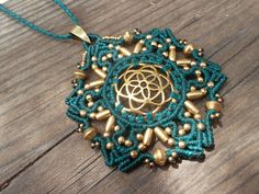 Powerful Seed of life crimped in this Mandala macrame pendant