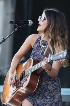 JUNE 14, 2015 2015 CMA Music Festival BMI singer/songwriter Maren Morris performs at the BMI Tailgate stage at CMA Fest. Her mix of indie, folk rock and country was a perfect blend to get the crowd moving.
