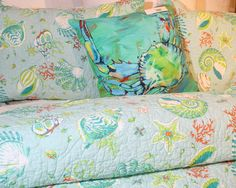 Jen Callahan's colorful under the sea pillows include this brightly lit crab, hanging out on a bed of Laguna Beach!