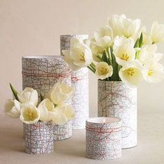 Martha Stewart Weddings. Old Maps used to make a unique centre table display, wrap them around vases or tins or jars