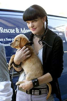 Pauley Perrette (from NCIS) holding a puppy. Your argument is invalid.