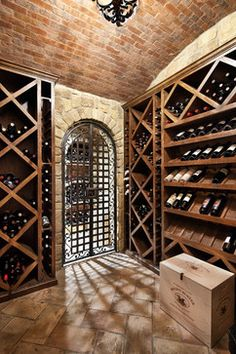 English Manor - traditional - wine cellar - houston - JAUREGUI Architecture Interiors Construction, stone and brick