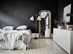 A dramatic Swedish space with black walls. Entrance.