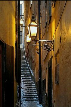 Mårten Trotzigs Gränd is an alley in Gamla stan, the old town of Stockholm, Sweden. The width of its 36 steps tapers down to a mere 90 cm, makes the alley the narrowest street in Stockholm. Oh The Places You'll Go, Places To Travel, Sweden Stockholm, Stockholm 2017, Scandinavian Countries, Street Lamp, Stairway To Heaven, Helsinki, Belle Photo