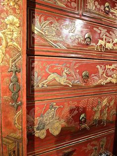 Detail of a George II scarlet and gilt-jappaned secretaire cabinet from Thomas Coulborn & Sons. With incredibly intricate chinoiserie decoration, the piece, circa 1730, is attributed to the well known British cabinet maker Giles Grendey, whose Lazcano furniture, the largest recorded suite of 18th century English furniture, is represented in major museums, including the Victoria & Albert Museum, the Metropolitan Museum of Art.