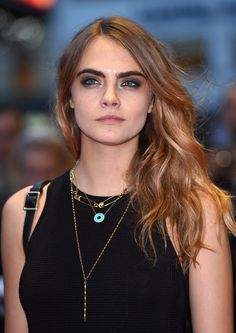 If you have bold brows like Cara, play them up with a smoky eye and jet black eyeliner.