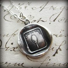 "This wax seal pendant depicts a mirror surrounded by the Italian motto ""Dico il Vero"" which translates roughly to ""A True Friend"" or ""You are looking at a True Friend""."