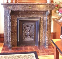Marble parlor fireplace, with screen, August Feine house, Buffalo, NY