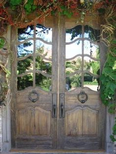 "These doors gave me an interesting idea for a covered patio or porch area... What if you could find some interesting salvage doors, put mirrors in the window panes and create a ""faux"" door vignette? I think there is a way to make it work... I want to remember this idea for our next home..."