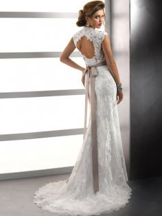 I LOVE this dress and everything about it. The open back, the lace, the off-color ribbon contrast. Love, love, love.