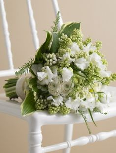 """Love this Sweet Pea and Ranunculus bouquet voted """"bouquet of the moment"""" on The Knot"""