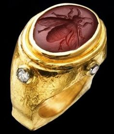 Garnet intaglio bee ring - set with diamonds and made by Whitney Abrams.