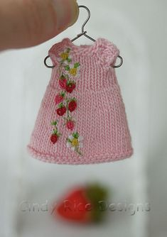 """Strawberry Fields"", an itty bitty OOAK hand knit & embroidered dress for Amelia Thimble dolls. ( How Sweet and Adorable is this? Knitting Dolls Clothes, Crochet Doll Clothes, Knitted Dolls, Crochet Toys, Crochet Baby, Knit Crochet, Knit Cowl, Crochet Granny, Hand Crochet"