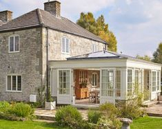 30 Bright and Beautiful Sunroom's Farmhouse Design Ideas Do you want to try a new inspiration for your home? or maybe your house has long you do not renovate and want your renovation. Or maybe your house lacks the intake of more light to keep your house … Orangerie Extension, Extension Veranda, Conservatory Extension, Orangery Extension Kitchen, Kitchen Orangery, Orangery Conservatory, Garden Room Extensions, House Extensions, Sunroom Addition