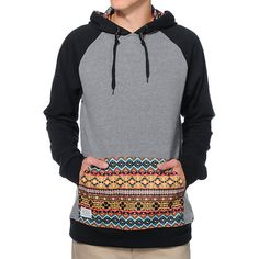 Grab a new level of style with the Empyre Argent charcoal and black print pocket pullover hoodie. Instantly improve your outfit with a charcoal body, black raglan sleeves, tribal print kangaroo pocket and hood lining, faux leather Empyre tag at upper back and left sleeve, and a soft fleece lining.