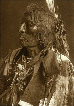 Slow Bull, Oglala Sioux warrior and medicine man (1907) postcard, photo by Edward S. Curtis, Azusa Publishing, Englewood, Colo., c2007