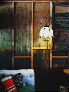 Everything about this! Love it. Nouveau lamp, wooden walls, mix-match toned down primary pillows