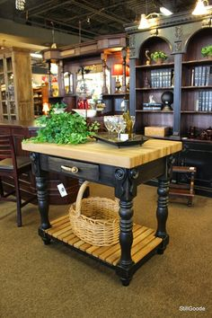 """Very nice solid kitchen island by the Paul Michael Company with black painted base and 2.5"""" thick butcher block top.  Island has French drawer with copper accented horn handles and slatted shelf in base. #OnTheShowroomFloor #StillGoode #Island"""
