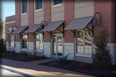 DAC Architectural Standing Seam Awnings & Corrugated Aluminum Canopies are custom design and manufactured to meet your projects panel and color specifications. Metal Door Awning, Metal Awnings For Windows, Aluminum Awnings, Window Awnings, Corrigated Metal, Red Brick Exteriors, Red Bricks, Canopy, Cottage
