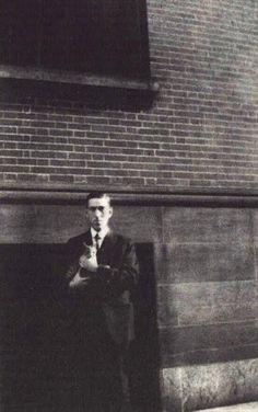 Photograph is Lovecraft with Frank Belknap Long's cat, Felis. Believed to have been taken in 1925.