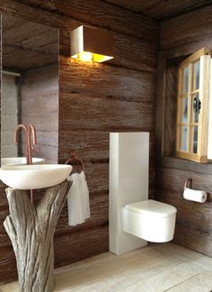 Love the rustic sink base and ultra comtemporary loo!