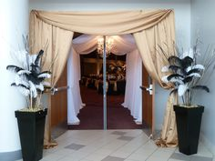 Great Gatsby Entrance in gold