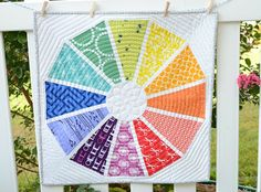 No pattern but she describes how to make it. I really want a colorwheel quilt. I think I could make this one.