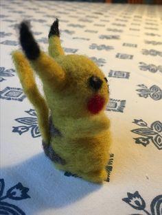 Needle felt Pikachu. Side view.