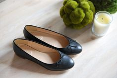 A pair of classic black leather flats - j.crew's kiki flats. instant chic.