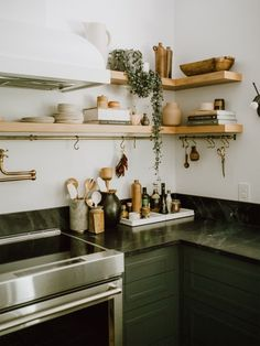 This Green Kitchen Taught Us Six Save Vs. Splurge Remodel Lessons Interior designer Jaclyn Peters shares six big splurge and save moments from a gorgeous green kitchen remodel in Winnipeg. Kitchen Corner, New Kitchen, Kitchen Dining, Dark Green Kitchen, Green Kitchen Decor, Kitchen Plants, Boho Kitchen, Tall Kitchen Cabinets, Kitchen Shelves