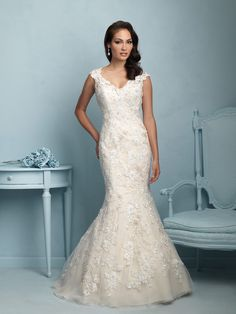 Allure 9220 Floral appliques add dimension to our elegant fit-and-flare gown.