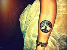 the tree of life, love these  tattooos if i get one it will probably be a tree of life