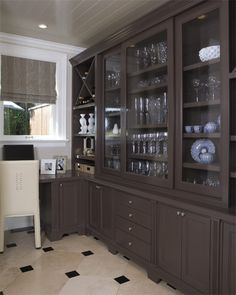 Chocolate accent piece with painted ceiling and white trim. (Master)