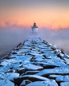 Arctic Sea Smoke billows around the Spring Point Ledge Lighthouse in South Portland, Maine