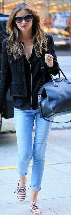 Who made  Miranda Kerr's black sunglasses, tweed jacket, leather handbag, and stripe flat shoes?