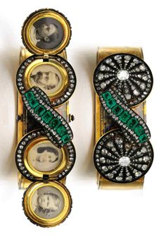 A Victorian emerald and diamond bangle, 1870s. Set to the front with a ribbon motif set with step-cut emeralds and rose diamonds between two rosettes set with further rose and cushion-shaped diamonds, each opening to reveal two glazed compartments containing portraits. #Victorian #antique #bangle