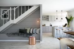 Love this Sycon Stria cladding used indoors with bench seat under the stairs. Great use of space, would just add storage under the bench (if it didn't!) Three Birds Renos