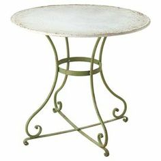 """Enjoy Sunday brunch on your three-season porch or tea in the breakfast nook around this charming metal bistro table, showcasing scrolling legs and a distressed green finish.     Product: Bistro tableConstruction Material: MetalColor: Distressed greenFeatures: Scrolling legsDimensions: 28"""" H x 31"""" Diameter"""