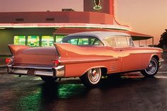 Cadillac Coupe de Ville - Gotta be a 58 -- those 4 chrome bars were on my daddy's 58 Olds