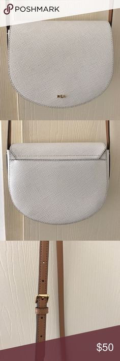 Ralph Lauren Satchel Super cute leather satchel purse from Ralph Lauren. It's in pretty much perfect condition! I don't have the tassel it came with, but it looks adorable with a little scarf tied on the strap where the tassel would be. Very lightly used. Lauren Ralph Lauren Bags Crossbody Bags